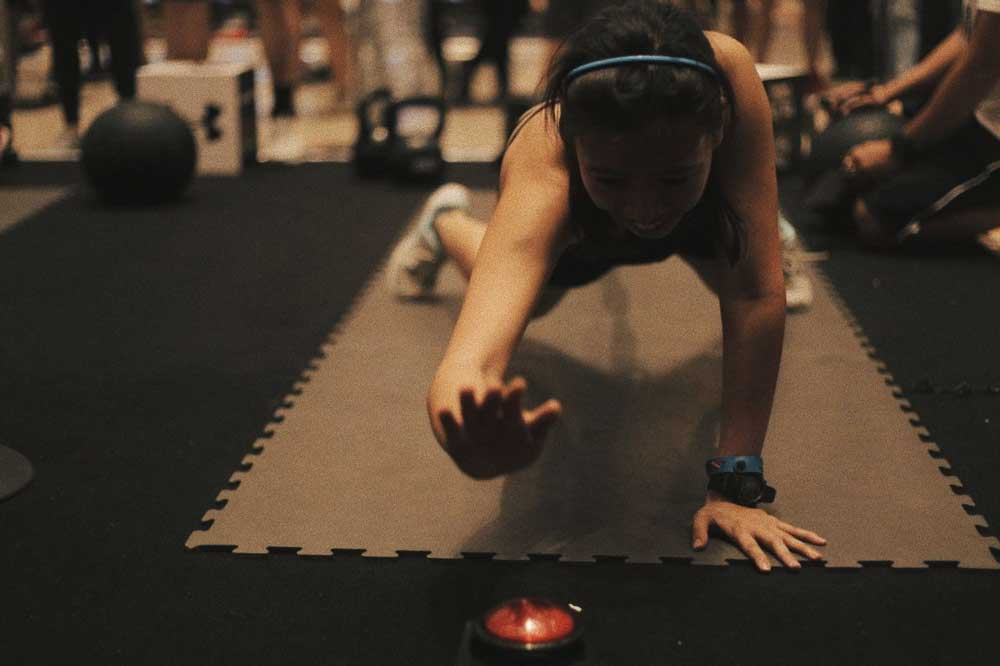 A participant executes the bear crawl challenege.
